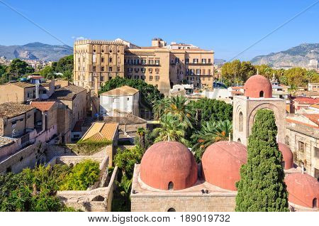 The famous red domes of the Church of St. John of the Hermits (San Giovanni degli Eremiti) and the Norman Palace (Palazzo dei Normanni) - Palermo Sicily Italy