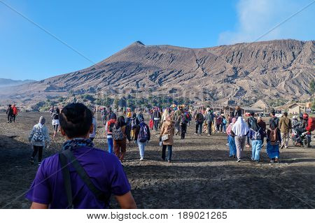 Java,Indonesia-May 10,2017:Tourists hiking on trail along to Mount Bromo,Java,Indonesia.Mount Bromo is an active volcano & attraction place for tourist to visit in Indonesia.