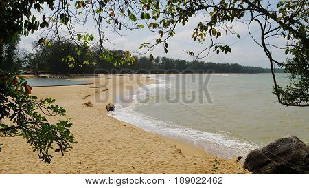 Ao Manao Beach, Narathiwat Waves gently lapping on the stretch of soft powdery sand of Ao Manao Beach in Ao Manao Beach, Narathiwat, Thailand