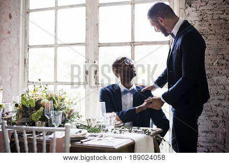 Newlywed gay couple at wedding reception
