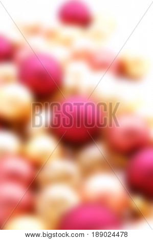 Long row of Christmas ornaments on white - blurred image for backgrounds
