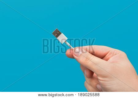 Closeup of USB cable connection. Isolated on blue background