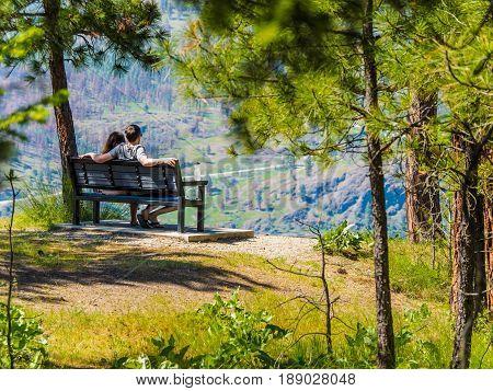 Couple on a bench enjoying mountain view