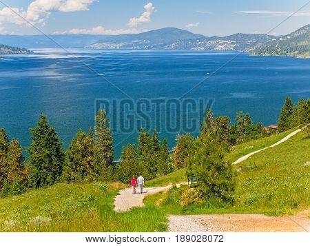Couple enjoying mountain hike on a summer day