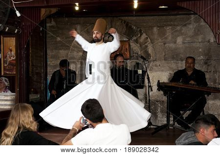 Istanbul, Turkey - May 7, 2017: The dance Whirling Dervishes is called Sema while peoples watch him