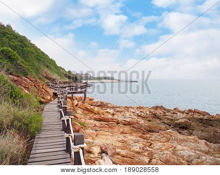 wooden walkway bridge with mountain landscape against blue sky at Khao Laem Ya National Park Rayong Province Eastern Thailand