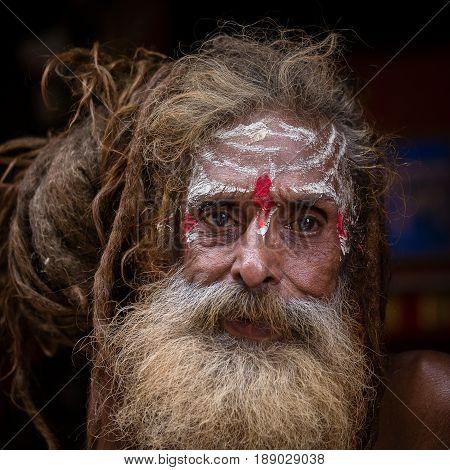 KATHMANDU NEPAL - OCTOBER 25 2016 : Portrait of Shaiva sadhu holy man in Pashupatinath Temple . Close up