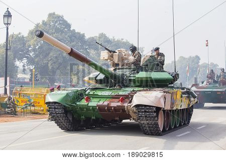 NEW DELHI INDIA - JANUARY 23 2017 : Battle Tank and military men take part in rehearsal activities for the upcoming India Republic Day parade. New Delhi India