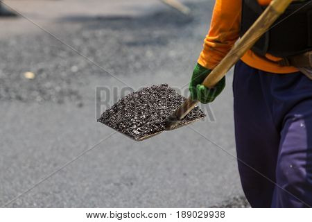 Closeup Worker working in roadwork construction site