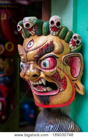 Colorful wooden masks and handicrafts on sale at shop in the Thamel District of Kathmandu Nepal.. Close up