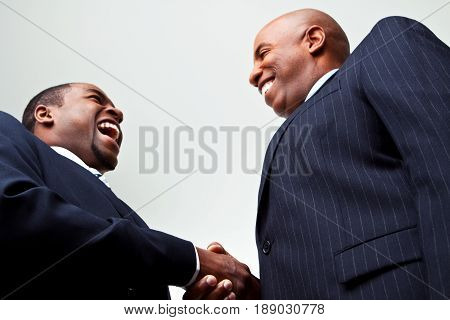 African American businessmen making a deal shaking hands.