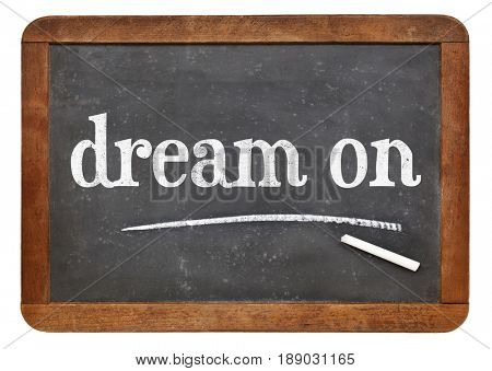 dream on - white chalk text on a vintage slate blackboard