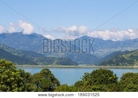 Lake Phewa in Pokhara Nepal with the Himalayan mountains in the background