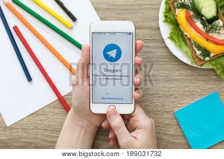 Alushta Russia - May 24 2017: Woman holding iPhone with social networking service Telegram on the screen. iPhone was created and developed by the Apple inc.