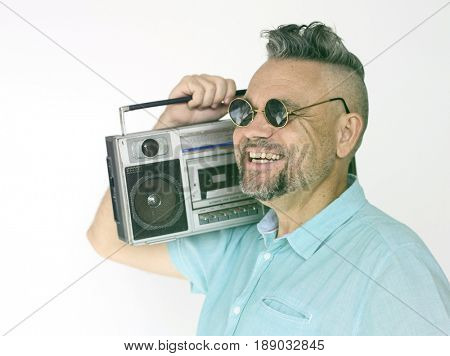 Senior man holding stereo media on white background