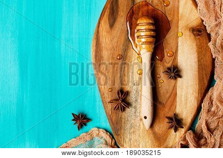 Honey With Special Spoon On A Chopping Board