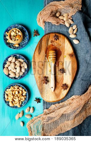 Nuts And Honey On A Rustic Table