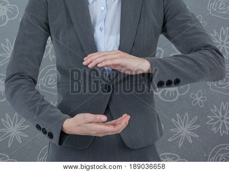 Digital composite of Businessman holding invisible object with pattern background
