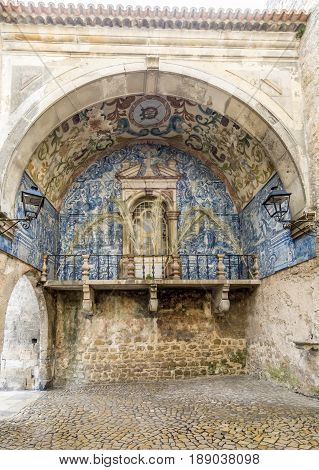 Obidos city gate with azulejo decoration in Portugal