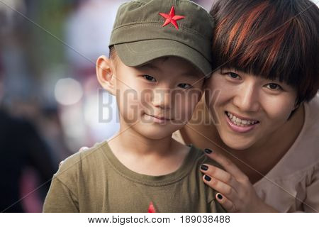 Chinese mother and son smiling