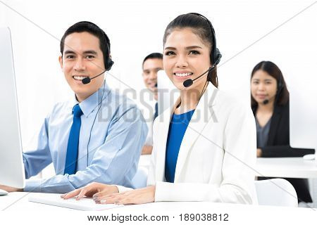 Asian call center (or telemarketer) team in the office