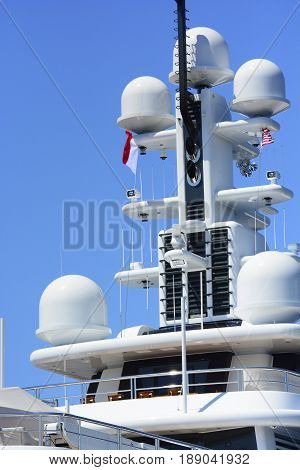 Massive array of antennae radars and exhaust pipes.
