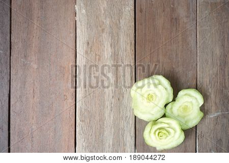 cut off vegetable in flower shape on wood background