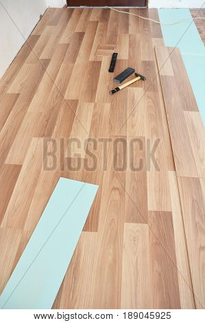 Installing laminate flooring tools. Laminate flooring installation interior.