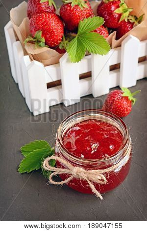 Ingredient For Healthy Breakfast. Homemade Jam In Open Glass Jar With Fresh Strawberry In White Box