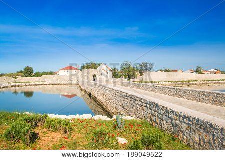 Dalmatian landscape, stone bridge in town of Nin, Dalmatia, Croatia