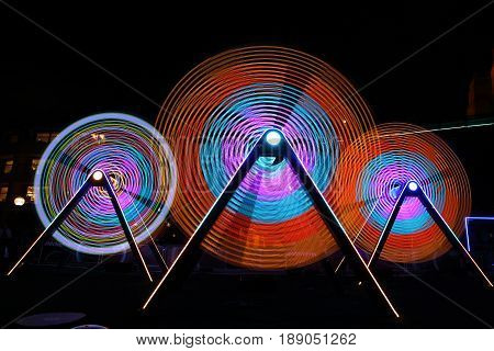SYDNEY AUSTRALIA - MAY 31 2017; Freedom of Movement by Ford is a set of humble swings that light and move to music. The installation is a celebration of innovation that uses colour light sound and motion.