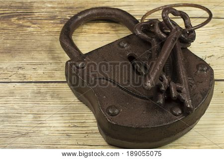 An old padlock with three old keys