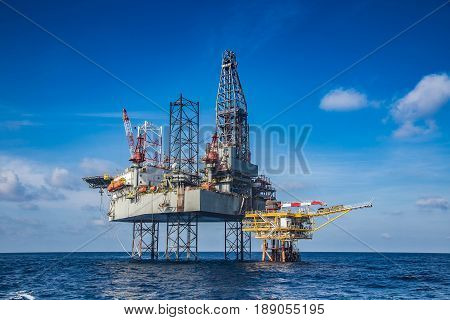 Offshore oil and gas drilling rig while completion well on oil and gas wellhead remote platform.