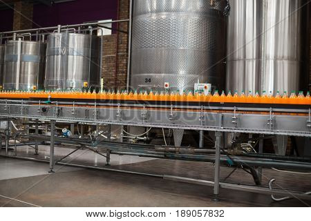 Cold drink bottles on the production line at drinks production factory