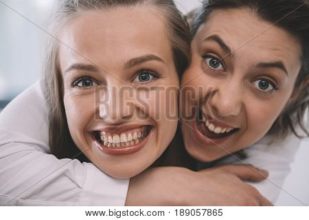 Portrait Of Beautiful Excited Homosexual Couple Embracing And Smiling