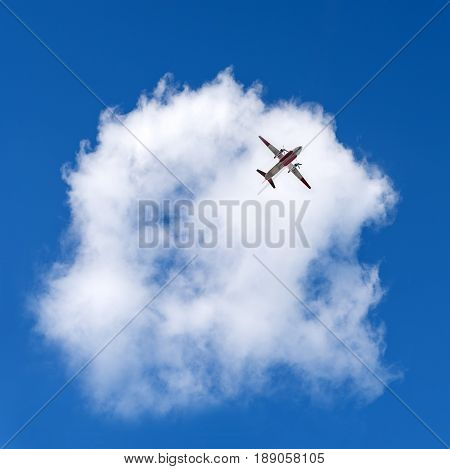 Airplane in the sky and beautiful cloud. Business summer vacation and travel adventure concept.
