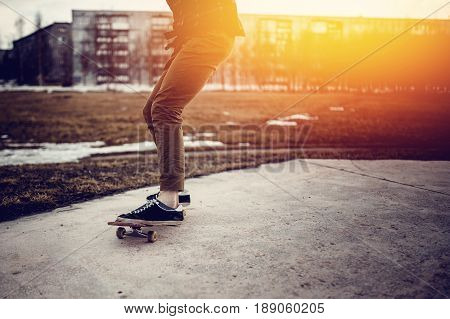 skateboarder guy prepares for a stunt on a skateboard and rides along the road. Concept forward to the goal and achieve it. poster