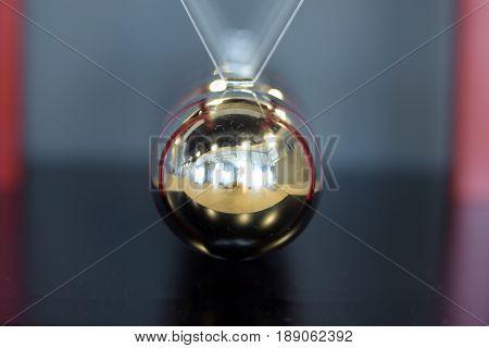 close up 5 Balls Pendulum, chrome Newton's cradle