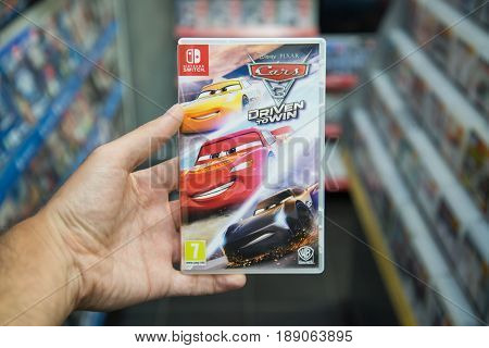 Bratislava, Slovakia, June 1 2017: Man holding Cars 3 Driven To Win videogame on Nintendo Switch console in store