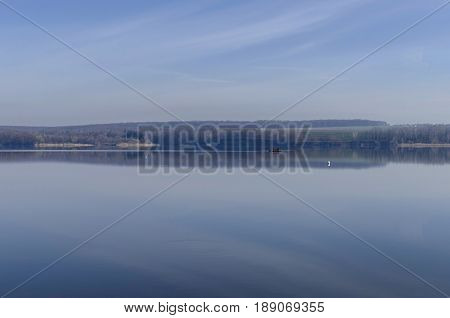 River landscape. Calm river in morning. Sky and water
