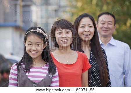 Chinese family smiling together