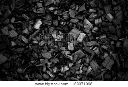 Dark Wooden chips for combustion in a biomass firing plant