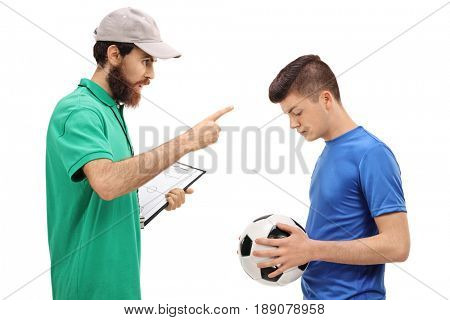 Coach scolding a teenage soccer player isolated on white background