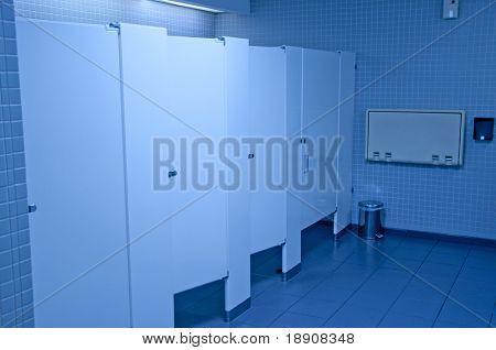 Public washroom stall with blue tone