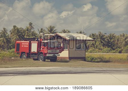 POLINESIA- JUNE 16: Fire-engine on a take-off field of small tropical island Tikehau on june 16 2011 in Polynesia