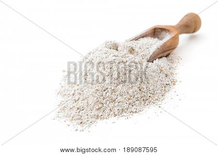 Rye flour in scoop on white background