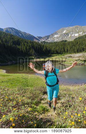 Hispanic hiker walking in rural landscape