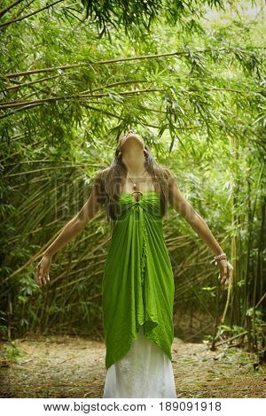 Pacific Islander woman standing in bamboo forest