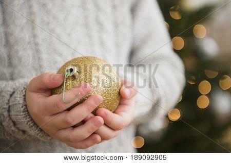 Caucasian girl holding Christmas ornament