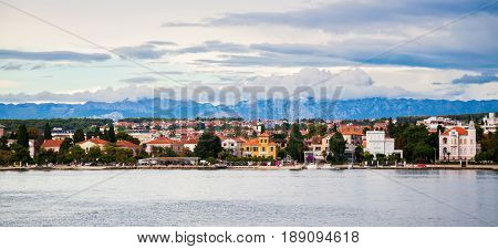 Zadar waterfront view with mountains Velebit in a distance Croatia